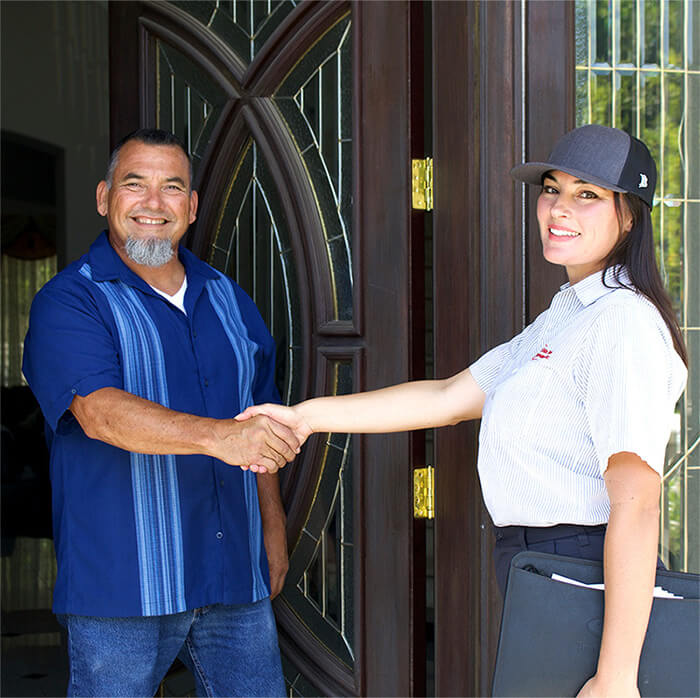 HVAC Technician with a satisfied customer