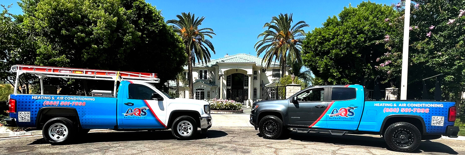 AQS Mechanical HVAC Service Trucks in Front of Customers Home