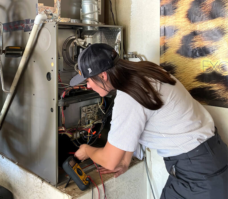HVAC Technician performing repairs and maintenance on a furnace